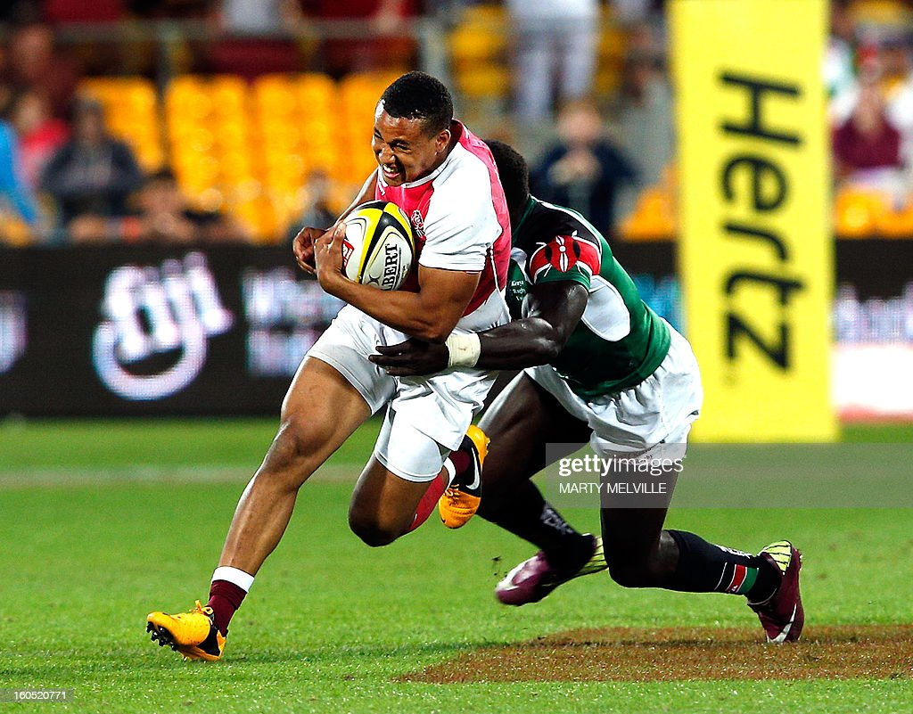 England's Marcus Watson (L) is tackled by Kenya's Oscar Ouma during the cup final at the Westpac Stadium on day two of the fourth leg of the IRB Rugby Sevens World Series in Wellington on February 2, 2013. AFP PHOTO / Marty MELVILLE
