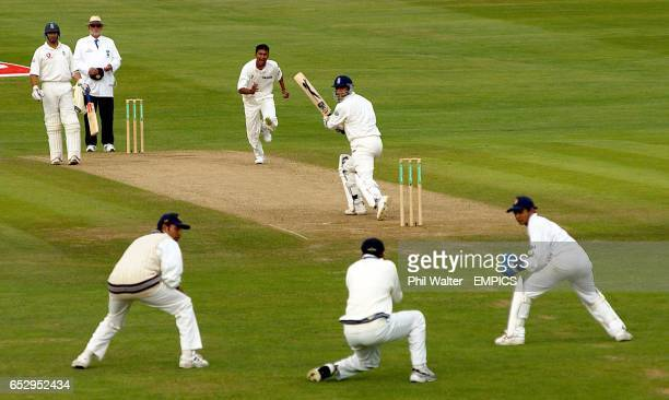 England's Mark Butcher is caught behind by India's Rahul Dravid off the bowling of Sanjay Bangar