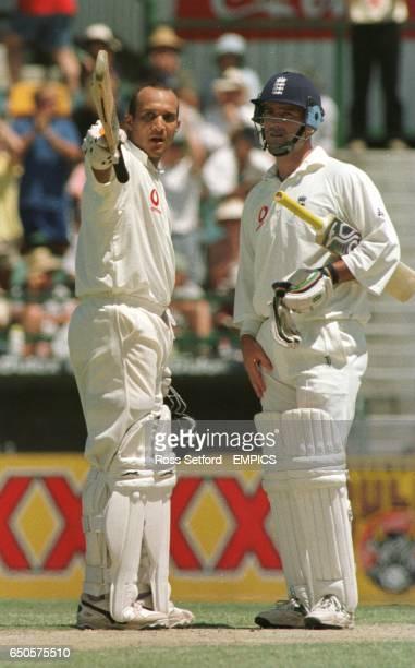 England's Mark Butcher salutes his century with Graham Thorpe against Australia