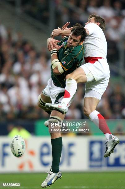 England's Mark Cueto and South Africa's Danie Rossouw jump for th ball