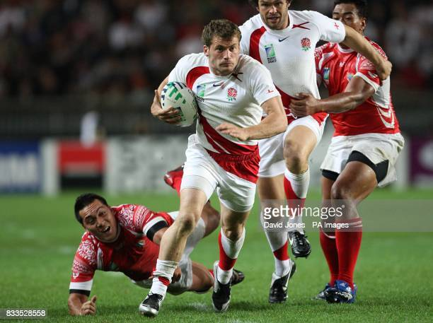 England's Mark Cueto gets away from Tonga's Pierre Hola