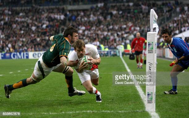 England's Mark Cueto goes over to try and score a try watched by the touch judge Joel Jutge