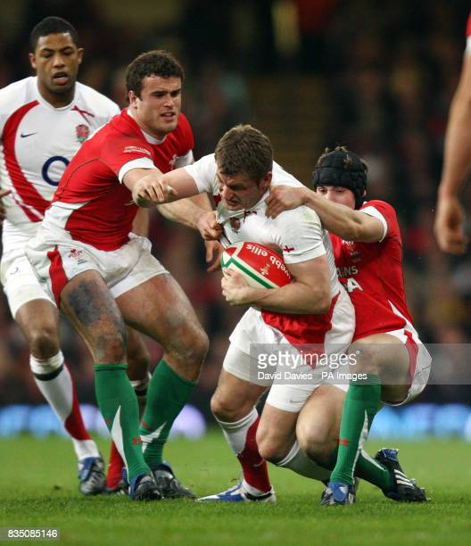 England's Mark Cueto is tackled by Leight Halfpenny and Jamie Roberts during the RBS 6 Nations match at the Millennium Stadium Cardiff