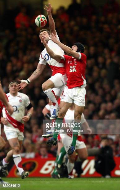 England's Mark Cueto jumps against Wales' Leigh Halfpenny to a high ball during the RBS 6 Nations match at the Millennium Stadium Cardiff