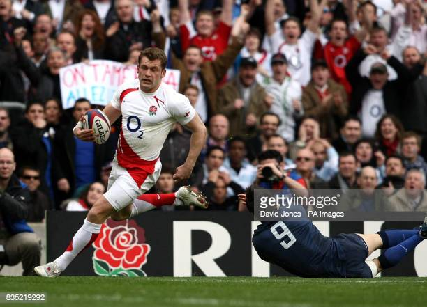 England's Mark Cueto runs past France's Morgan Parra to score the first try of the match during the RBS 6 Nations match at Twickenham London