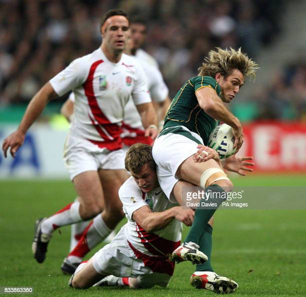 England's Mark Cueto tackles South Africa's Percy Montgomery during the IRB Rugby World Cup Final match at Stade de France Saint Denis France