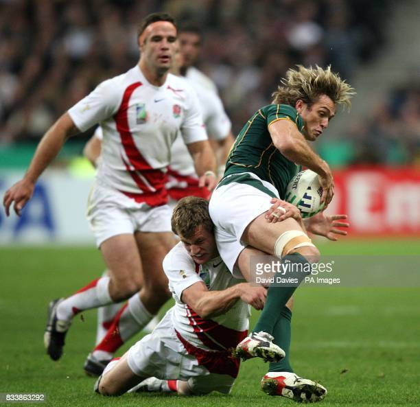 England's Mark Cueto tackles South Africa's Percy Montgomery