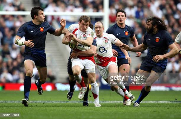 England's Mark Cueto takes on the France's Damien Traille during the RBS 6 Nations match at Twickenham London