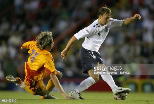 England's Mark Noble and Romania's Ciprian Deac