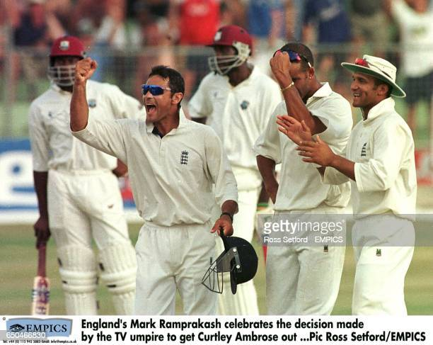 England's Mark Ramprakash celebrates with teammates Dean Headley and Mark Butcher after the third umpire gave West Indies batsman Curtly Ambrose out