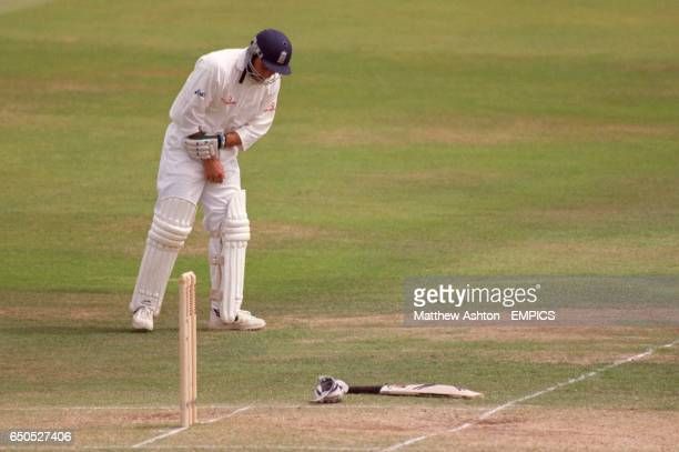 England's Mark Ramprakash holds his wrist after being hit by a delivery from South Africa's Allan Donald