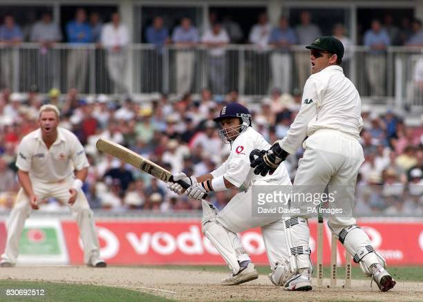 England's Mark Ramprakash sweeps Australian spinner Shane Warne as wicketkeeper Adam Gilchrist looks on on the third day of their npower Test match...