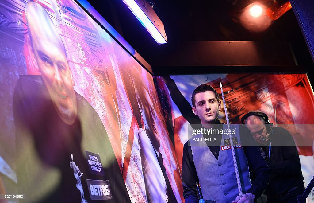 England's Mark Selby arrives for the third session of the World Snooker Final in Sheffield, northern England on May 2, 2016. / AFP / PAUL