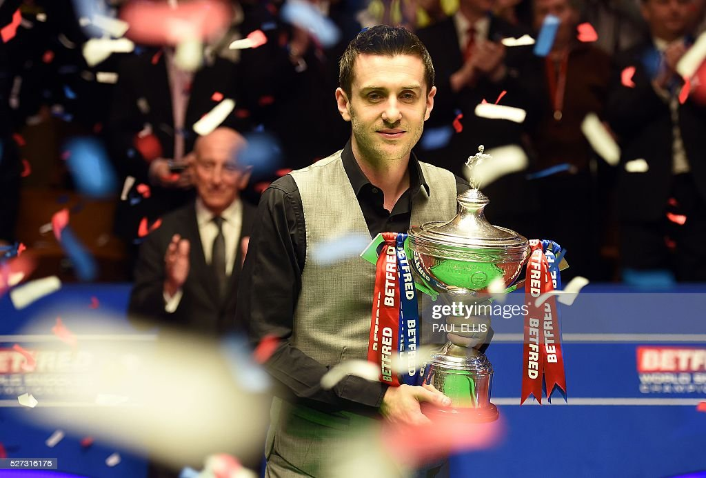 England's Mark Selby holds the trophy after beating China's Ding Junhui in the final of the World Snooker Championship at the Crucible theatre in Sheffield, northern England, on May 2, 2016. / AFP / PAUL