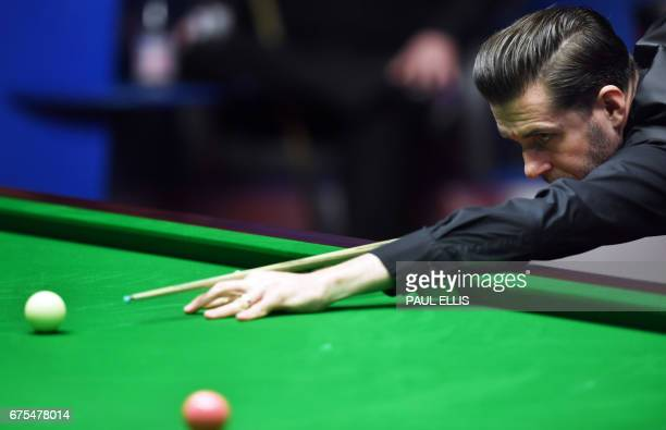 England's Mark Selby plays during the World Championship Snooker final against Scotland's John Higgins at The Crucible in Sheffield England on May 1...