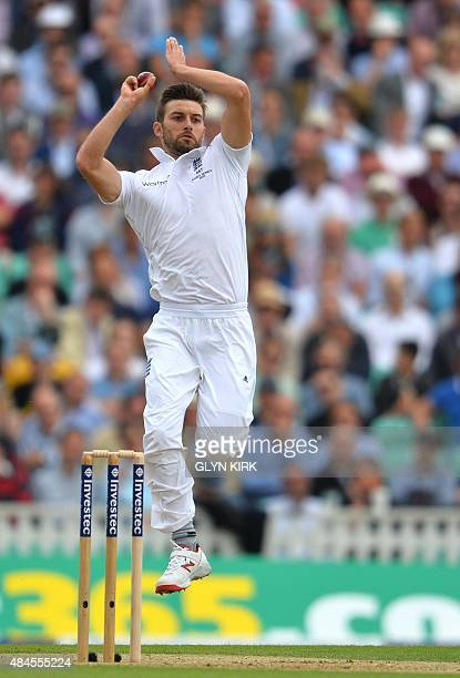 England's Mark Wood bowls on the first day of the fifth Ashes cricket Test match between England and Australia at the Oval in London on August 20...