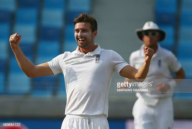 England's Mark Wood celebrates after dismissing Pakistan's Younis Khan during the first day of the second Test cricket match between Pakistan and...