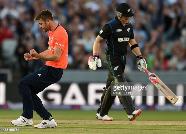 England's Mark Wood celebrates bowling out New Zealand's Brendon McCullum during the Twenty20 international cricket match between England and New...
