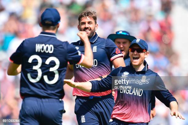 England's Mark Wood celebrates taking the catch off the bowling of England's Liam Plunkett with England's Eoin Morgan to take the wicket of...