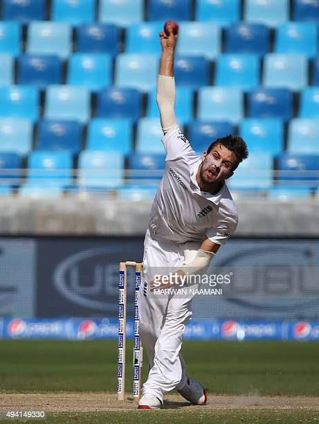 England's Mark Wood delivers a ball during the fourth day of the second Test cricket match between Pakistan and England in Dubai on October 25 2015...