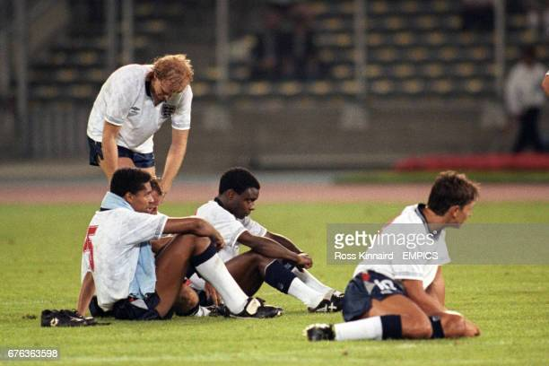 England's Mark Wright Des Walker Paul Parker and Gary Lineker sit on the grass as West Germany win the penalty shootout
