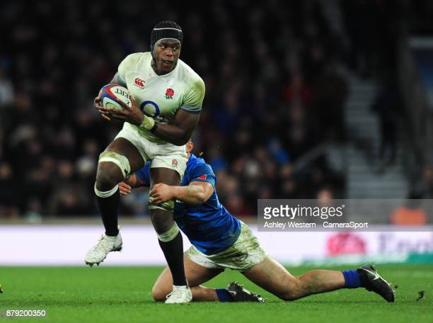 England's Maro Itoje is tackled by Samoa's Jack Lam during the 2017 Old Mutual Wealth Series Autumn International match between England and Samoa at...