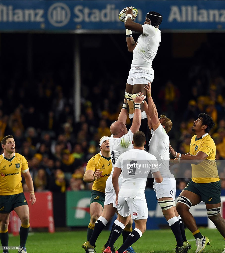 England's Maro Itoje (C-top) takes in the lineout ball against Australia during their third and final rugby union Test in Sydney on June 25, 2016. / AFP / SAEED
