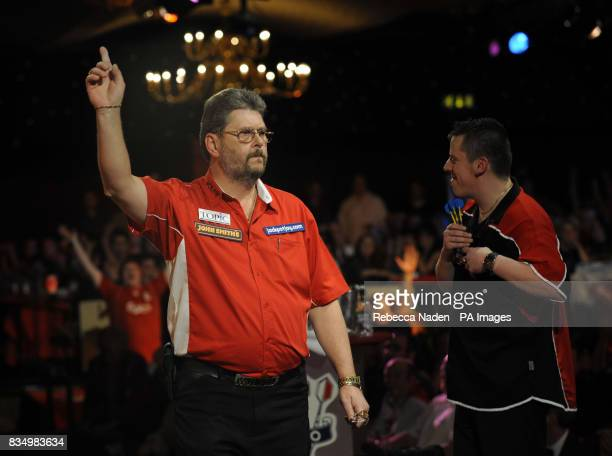 England's Martin Adams celebrates defeating Dave Chisnall during the World Darts Championship at Frimley Green Surrey