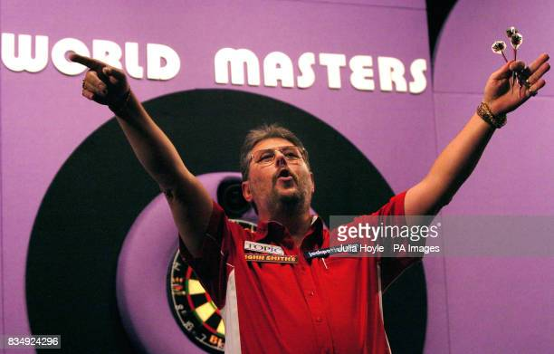 England's Martin Adams celebrates his victory in the Final of the Winmau World Masters at The Spa Bridlington
