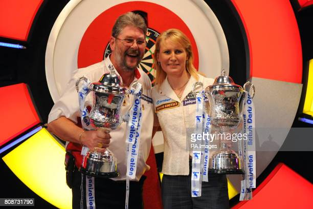 England's Martin Adams celebrates winning the BDO World Professional Darts Chamionship with Trina Gulliver winner of the women's BDO World...