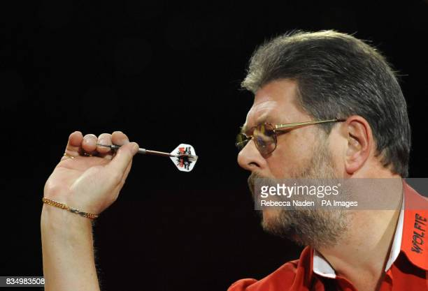 England's Martin Adams in action against Dave Chisnall during the World Darts Championship at Frimley Green Surrey