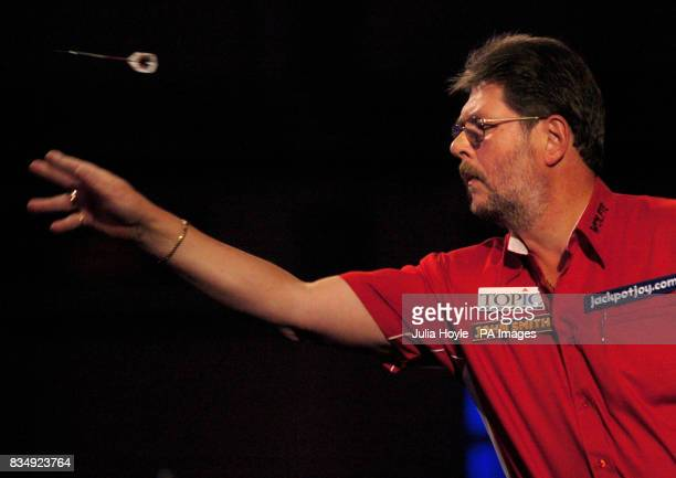 England's Martin Adams throws a dart in his semifinal match during the Winmau World Masters at The Spa Bridlington