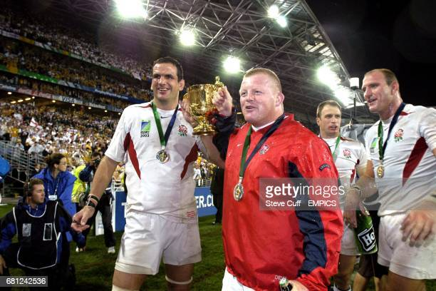 England's Martin Johnson celebrates with teammate Dorian West