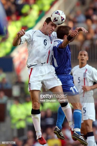 England's Martin Keown and Greece's Themis Nikolaidis battle for the ball