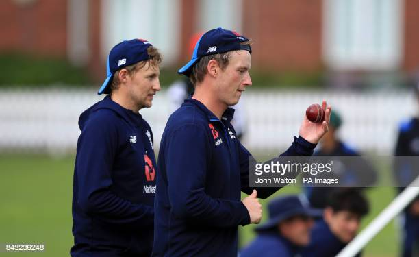England's Mason Crane and Joe Root during the nets session at Lords London