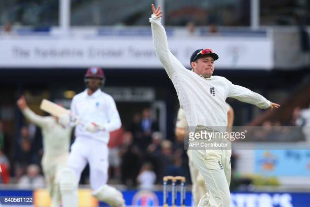 England's Mason Crane celebrates the wicket of West Indies' Roston Chase for 30 on the fifth and final day of the second international Test match...