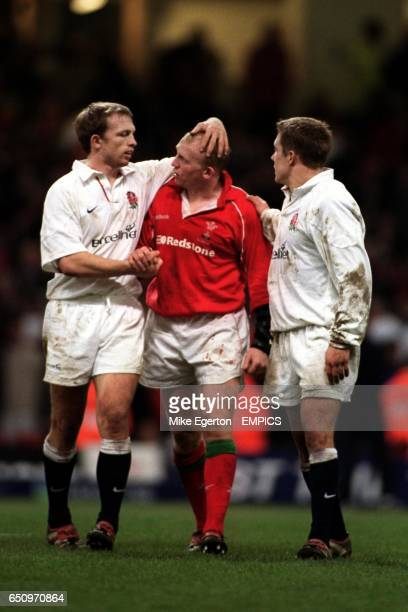 England's Matt Dawson and Jonny Wilkinson console Neil Jenkins after the final whistle