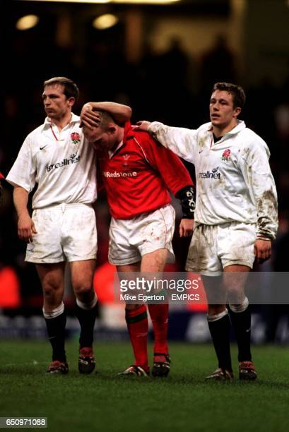 England's Matt Dawson and Jonny Wilkinson console Wales' Neil Jenkins after the final whistle
