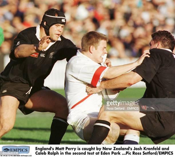 England's Matt Perry is caught by New Zealand's Josh Kronfeld and Caleb Ralph