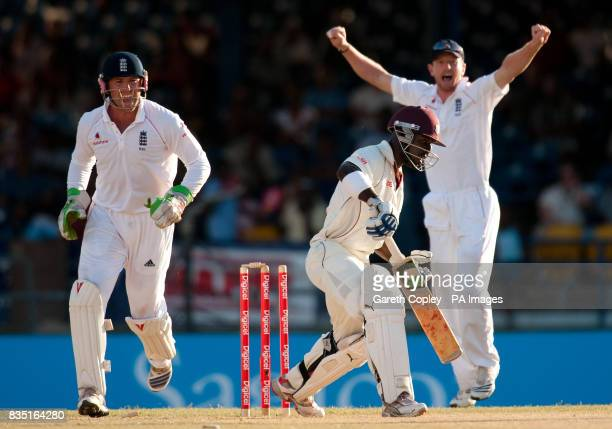 England's Matt Prior and Paul Collingwood celebrates as West Indies' Devon Smith is bowled by Monty Panesar during the fifth test at Queen's Park...