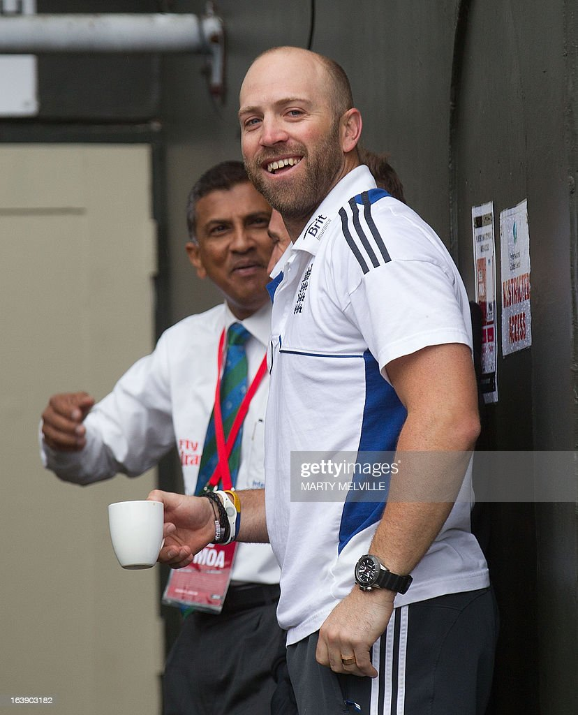 England's Matt Prior has a cup of tea as rain halts play during day five of the international cricket Test match between New Zealand and England played at the Basin Reserve in Wellington on March 18, 2013. AFP PHOTO / Marty MELVILLE