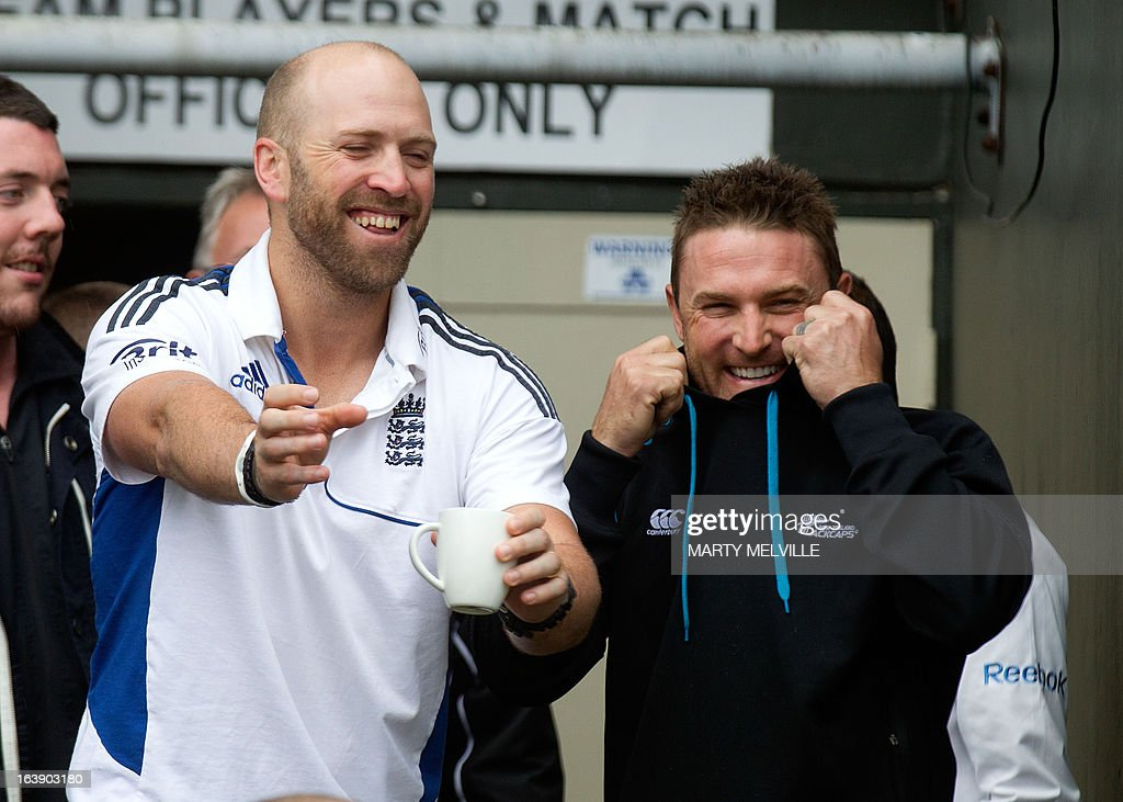 England's Matt Prior (L) jokes with New Zealand captain Brendon McCullum as rain halts play during day five of the international cricket Test match between New Zealand and England played at the Basin Reserve in Wellington on March 18, 2013. AFP PHOTO / Marty MELVILLE