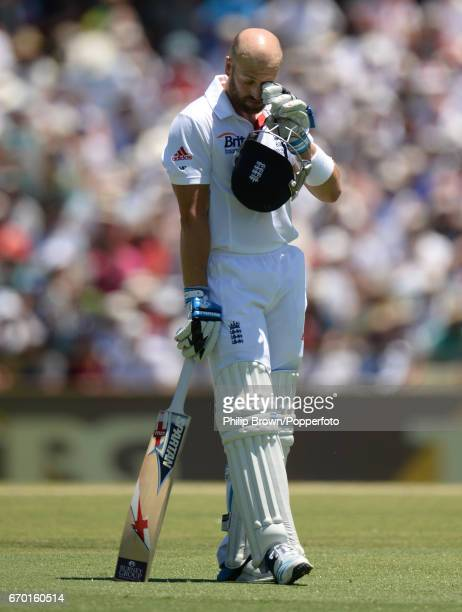 England's Matt Prior leaves the field after being dismissed during the 3rd Ashes cricket Test match between Australia and England at the WACA cricket...