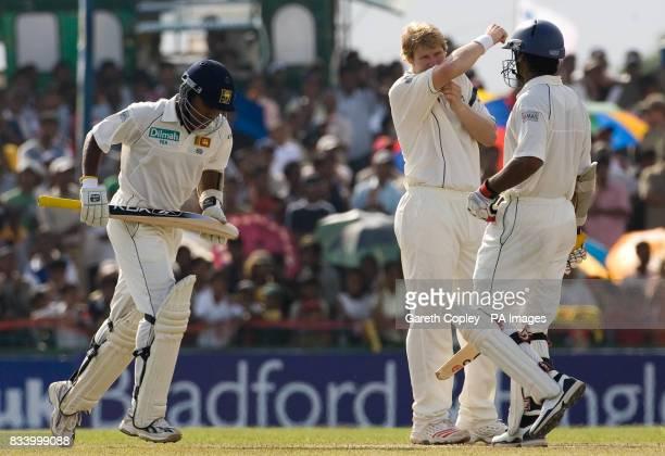 England's Matthew Hoggard wipes his brow as Sri Lanka's Mahela Jayawardene and Kumar Sangakkara run between the wickets during the Third Test Match...
