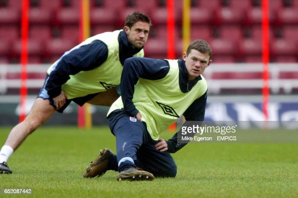 England's Matthew Upson and Wayne Rooney during warm up
