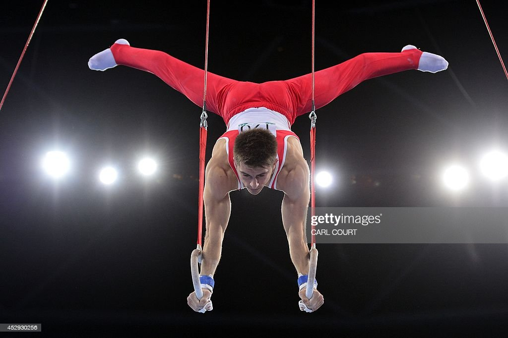 England's Max Whitlock performs on the rings during the men's all round final of the Artistic Gymnastics event during the 2014 Commonwealth Games in...
