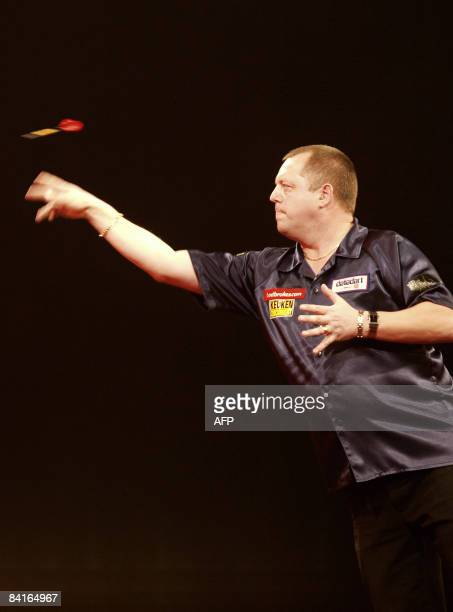 England's Mervyn King throws a dart during his semifinal match against fellow countryman Phil Taylor in the 2009 World Darts Championship at London's...
