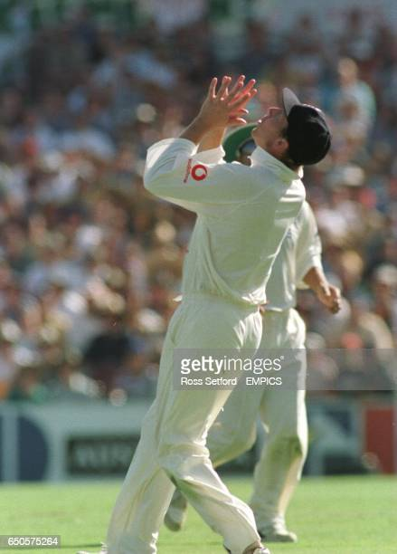 England's Michael Atherton prepares to take the catch of Australia's Glen McGrath off the bowling of Robert Croft to end the Australian first innings...