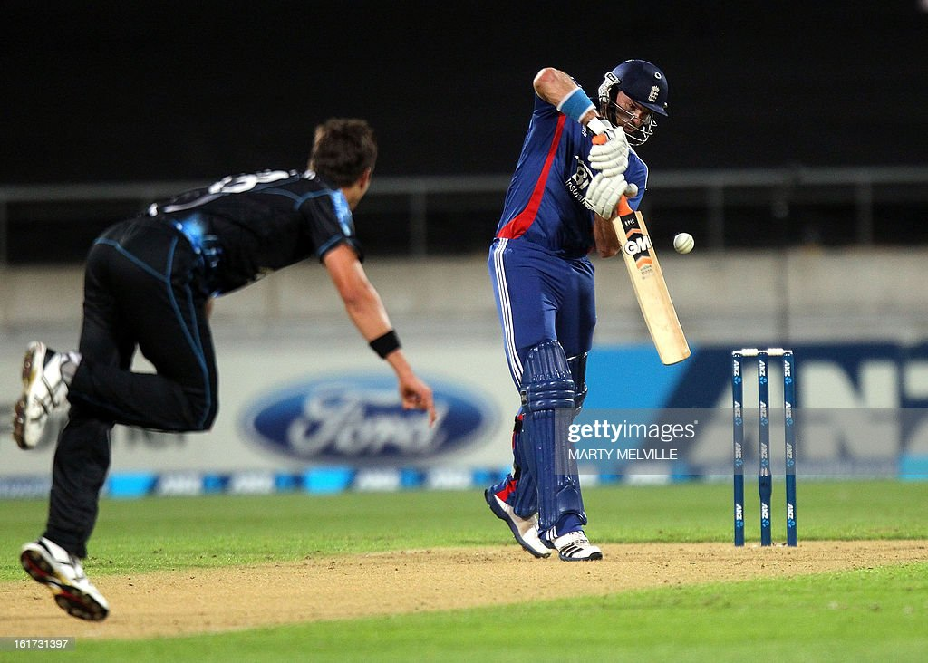 England's Michael Lumb (R) hits a ball delivered by New Zealand's Trent Boult during the International Twenty20 cricket match between New Zealand and England played at the Westpac Stadium in Wellington on February 15, 2013. AFP PHOTO / Marty MELVILLE