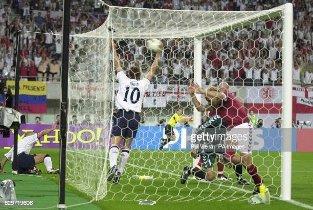 England's Michael Owen celebrates after Denmark goalkeeper Thomas Sorensen scored an own goal from a Rio Ferdinand header during the World Cup second...
